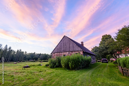 Tuinposter Purper dramatic sunset over countryside