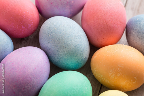 Fotografie, Obraz  Close up of Colorful Easter Egge on Wood Background