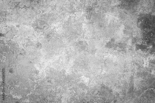 Fotobehang Betonbehang Close-up of a weathered and aged concrete wall, paint partly peeled off. Texture background in black and white with vignette.