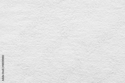 Fototapeta White towel texture for background. Flat and smooth with fabric or textile consist of cotton fiber material. Look plush, fluffy, dry, soft and clean. For background of baby, spa, hotel and laundry. obraz