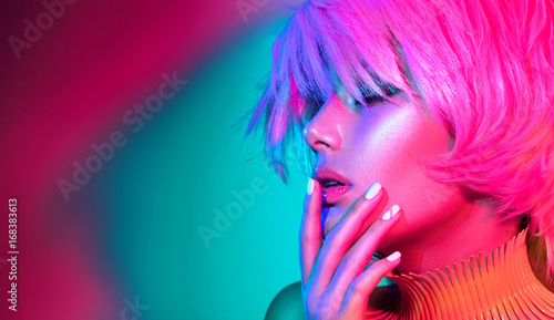 Foto op Plexiglas Beauty Fashion model woman in colorful bright lights, portrait of beautiful party girl with trendy makeup, manicure and haircut