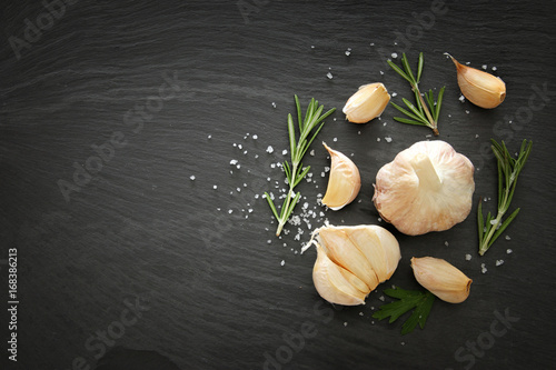 Image of garlic and rosemary on slate stone plate