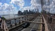 Wide shot standing on the Brooklyn Bridge showing the New York city and highway
