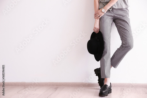 Fototapeta  Beautiful young woman in stylish casual clothes near white wall