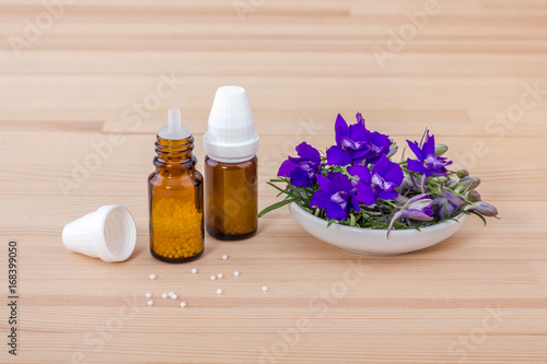 Photo Homeopathic medicines / Homeopathic remedy with blooming aconite