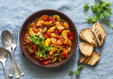 Healthy Vegetarian Lunch - Stewed Garden Vegetables. Vegetable Ratatouille And Grilled Bread. On A Blue Background, Top View