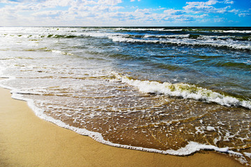 Fototapeta Morze Seascape with waves breaking on the beach. Baltic sea, Pomerania, northern Poland.
