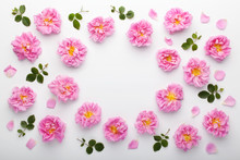 Frame Of Pink Damask Roses And Green Leaves On White Background. Flat Lay, Top View.