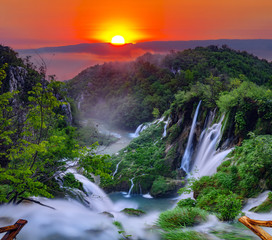 Fototapetasunrise over the waterfall in Plitvice ,Croatia