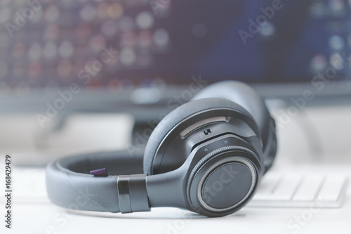 macro over-the-ear bluetooth headphones with active noise control on computer ke Wallpaper Mural