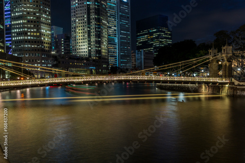 Old brightly illuminated bridge on the Singapore river at sunset  - 5 Poster