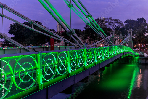 Old brightly illuminated bridge on the Singapore river at sunrise - 2 Poster