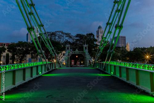 Old brightly illuminated bridge on the Singapore river at sunrise - 3 Poster