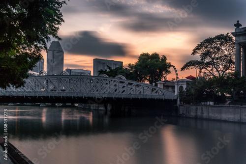 Old brightly illuminated bridge on the Singapore river at sunrise - 6 Poster