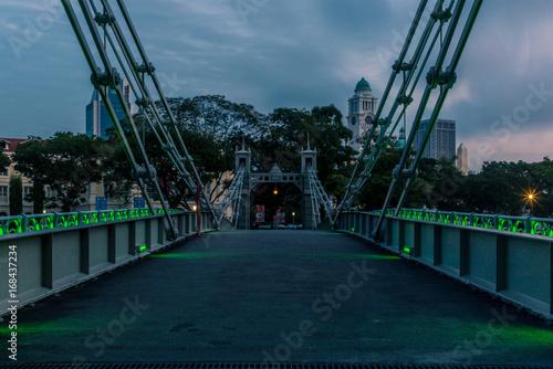 Old brightly illuminated bridge on the Singapore river at sunrise - 5 Poster