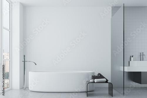 White bathroom, tiles and round tub