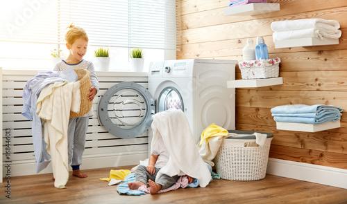 Happy Children Boy And Girl In Laundry Load Washing Machine Buy