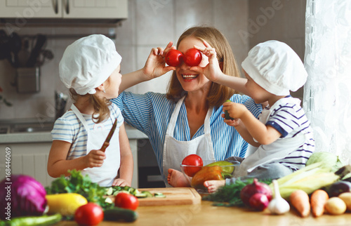 Poster Cuisine Healthy eating. Happy family mother and children prepares vegetable salad.
