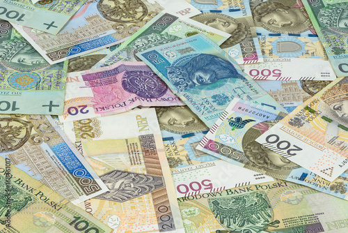 Poster  Background made of different polish zloty banknotes