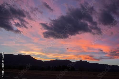 Foto op Aluminium Bergen Sunset with clouds