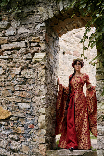 Fényképezés  Beautiful Isabella of France, queen of England on Middle Ages period in red gown