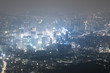 view on night highlighted Seoul city from N tower streets full of lights. South Korea.