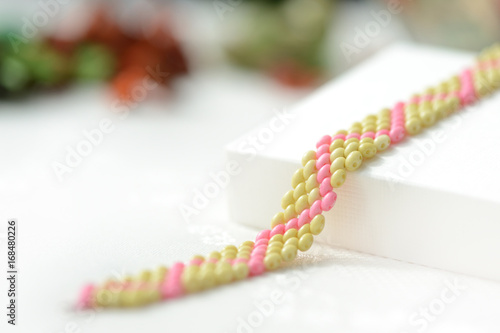Beaded anklet light green and pink color close up Canvas Print