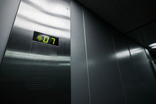 Interior Of The Elevator Inside. View Of The Panel With The Number And Steel Silver Lining.