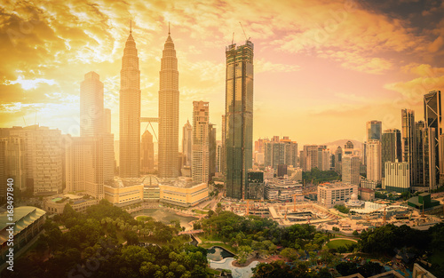 Cityscape of Kuala lumpur city skyline at sunset with sunlight in Malaysia.