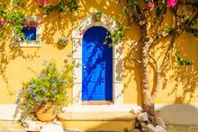 Blue Door Of A Yellow Greek Ho...