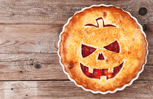 Delicious Homemade Pie For Halloween With A Filling Of Pumpkin-strawberry Jam And Peaches