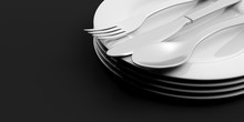 Stack Of Plates And Cutlery On...