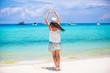 Young beautiful woman on tropical seashore. Happy girl in dancing on the beach