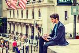 Fototapeta Nowy Jork - Young Businessman working on Wall Street in New York.