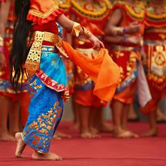 Balinese dancer girls in traditional Sarong costume dancing Legong dance