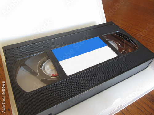 Fotografie, Obraz  Outdated videocassette . Old video tape on wooden table