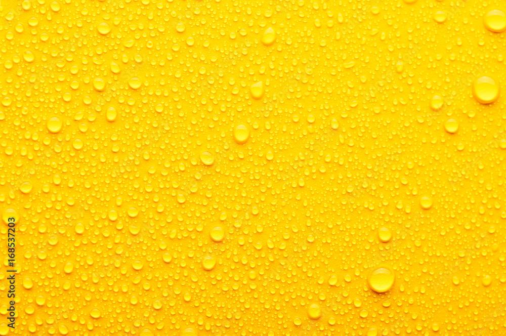 Fototapeta water drops on a yellow background