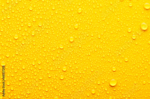 Fototapeta water drops on a yellow background obraz