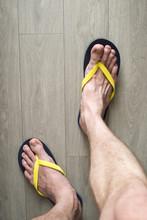 Blue Flip Flops On The Male Legs