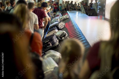 Obraz na plátně  Suitcase on luggage conveyor belt at baggage claim at airport