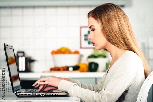 Fototapeta Beautiful caucasian woman working on laptop. obraz na płótnie