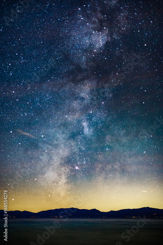 Spoed Foto op Canvas Nacht Starry Night and Milky Way above Lake Tahoe