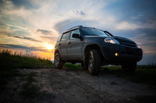 SUV With Big Wheels At Sunset