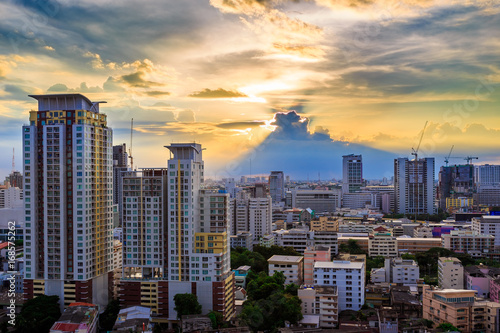Wall Murals Toronto Sunbeam and cityscape at sunset in Bangkok, Business district with high building at sunshine day, Bangkok, Thailand