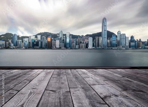 Photo  wood floor and Hong kong city skyline