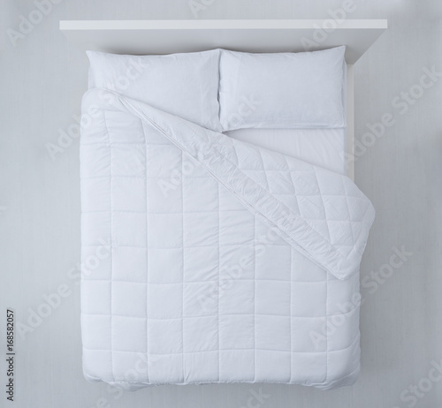 fototapeta na ścianę Elegant bed top view