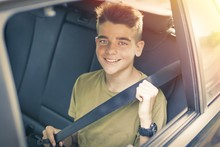 Child With Seatbelt In The Car
