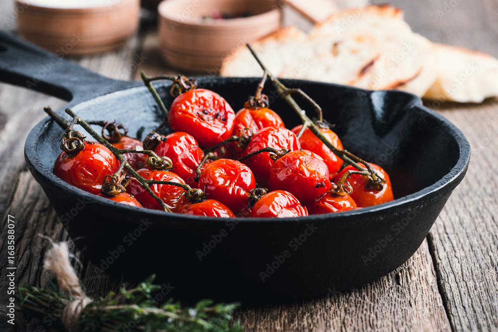Fotografie, Obraz  Roasted cherry tomatoes  in cast iron skillet