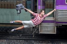 Man With Backpack Flies Behind...