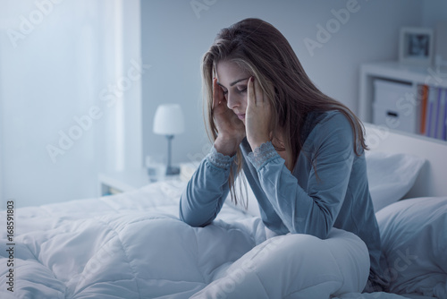 Fotografie, Obraz  Depressed woman awake in the night, she is exhausted and suffering from insomnia